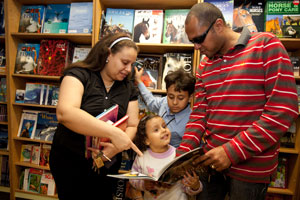 A family visit the book fair on Logos Hope